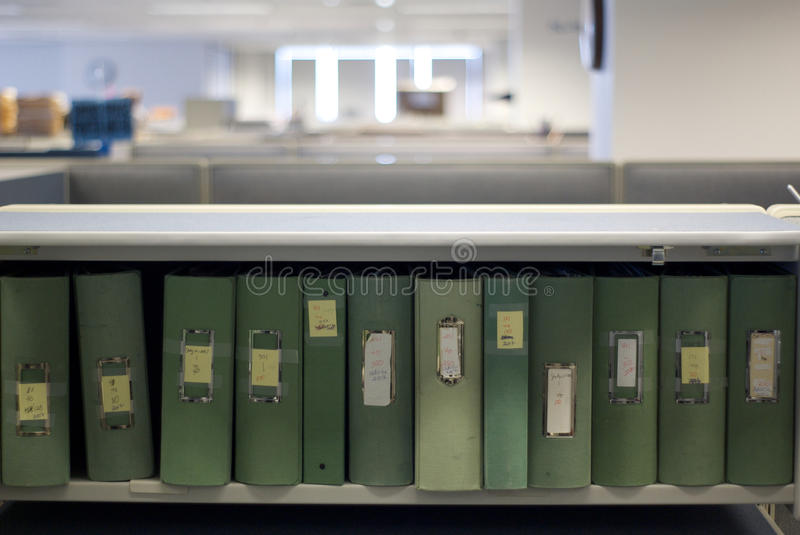 Binders in cubicle stock images