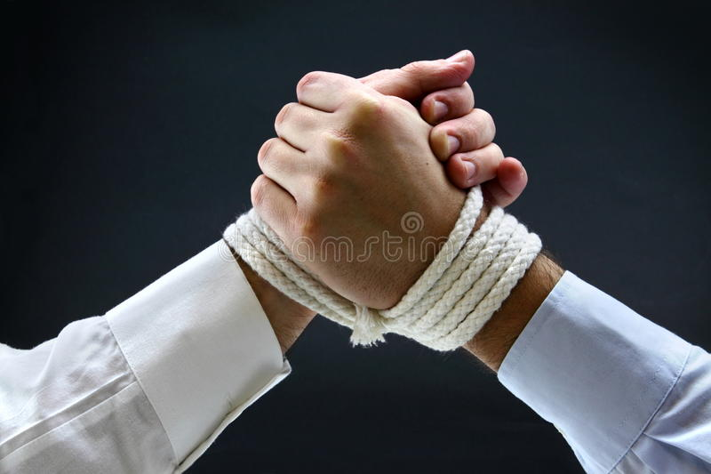 Binding contract. With two business men arm wrestling royalty free stock image