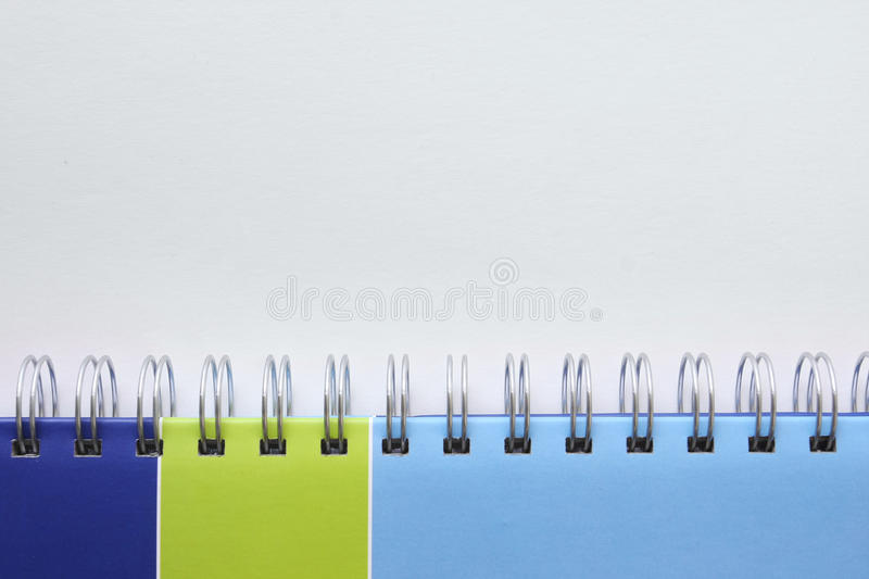 Binding rings on a note book stock images