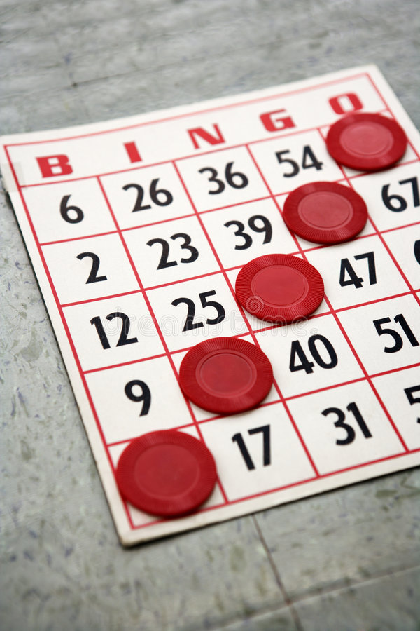 Bingo card with winning chips. royalty free stock image