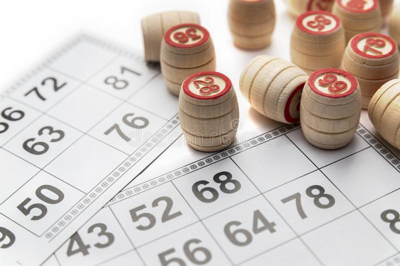 Bingo or lotto game. Wooden kegs of lotto on cards.  stock photo