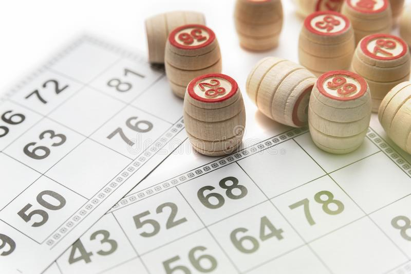Bingo or lotto game. Wooden kegs of lotto on cards.  stock photography