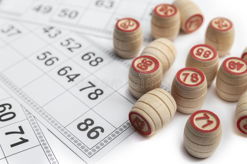 Bingo or lotto game. Wooden kegs of lotto on cards.  royalty free stock image