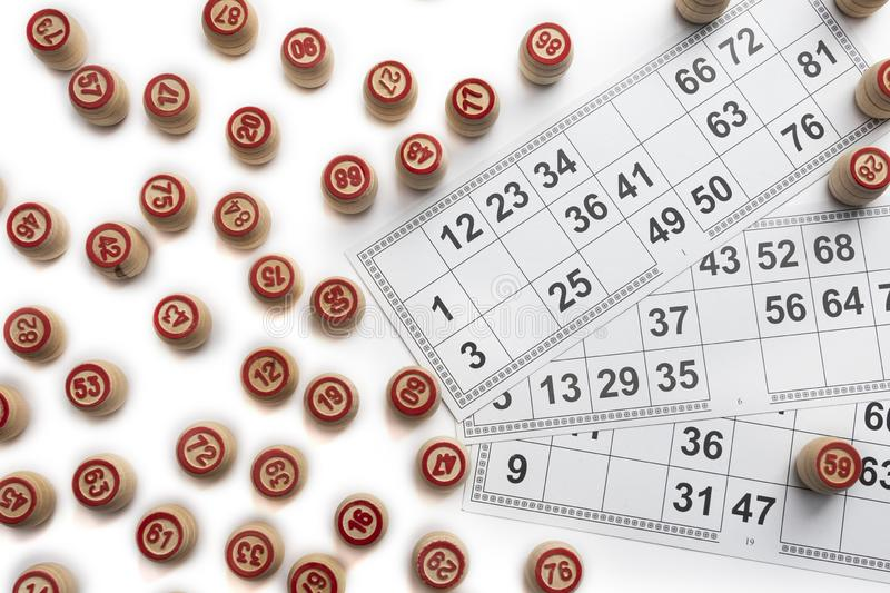 Bingo or lotto game. Wooden kegs of lotto on cards.  royalty free stock photo