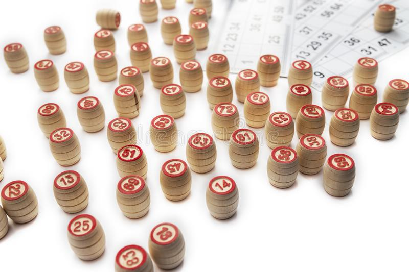 Bingo or lotto game. Wooden kegs of lotto on cards.  royalty free stock photos