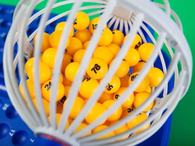 Bingo wheel with numbered balls inside stock photos