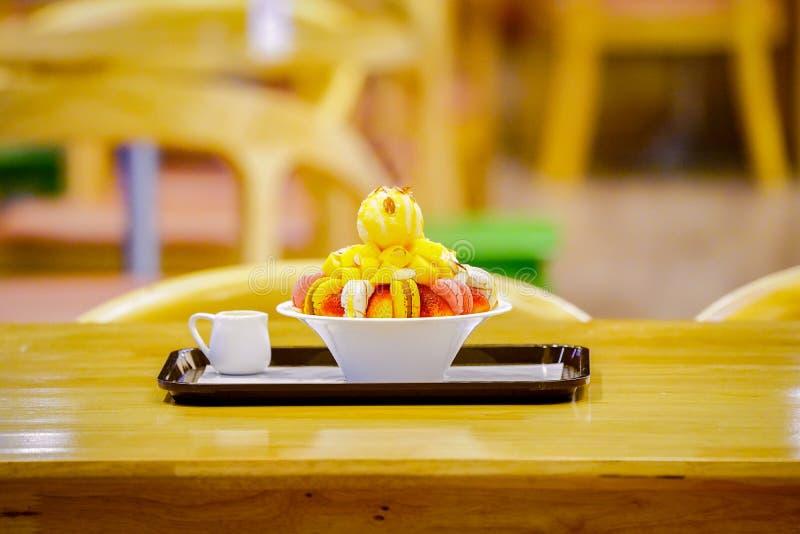 Bingsu, Asian ice, fresh summer dessert with macron, strawberry, almond and vanilla ice cream. Shaved and poured with sweetened. Bingsu, Asian ice, fresh summer stock image