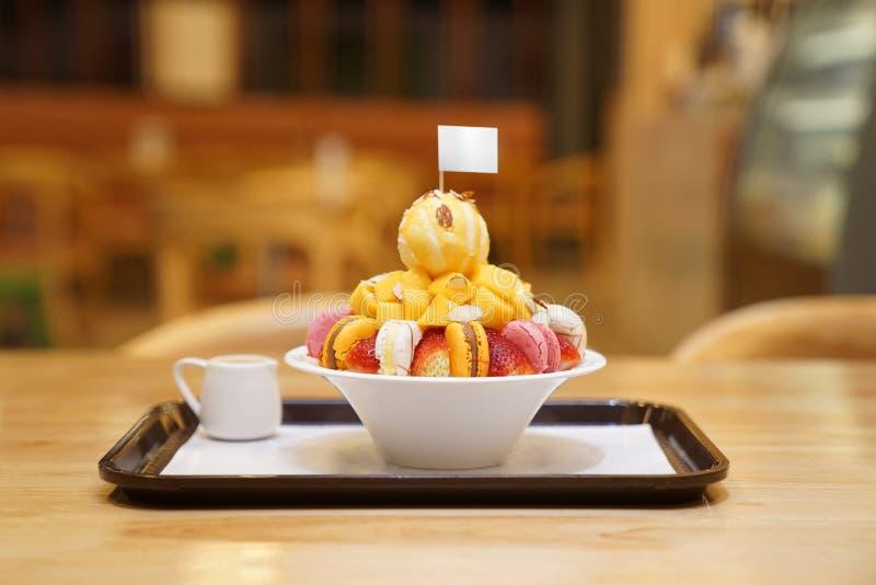 Bingsu, Asian ice, fresh summer dessert with macron, strawberry, almond and vanilla ice cream. Shaved and poured with sweetened. Bingsu, Asian ice, fresh summer royalty free stock images