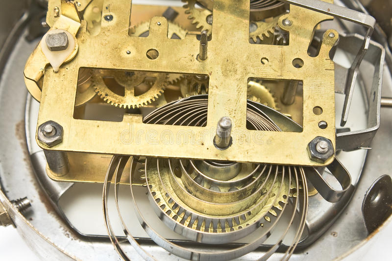 Binnen mechanisme van oude klok stock afbeeldingen