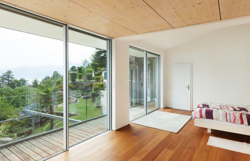 Binnenlands, modern huis, slaapkamer stock fotografie
