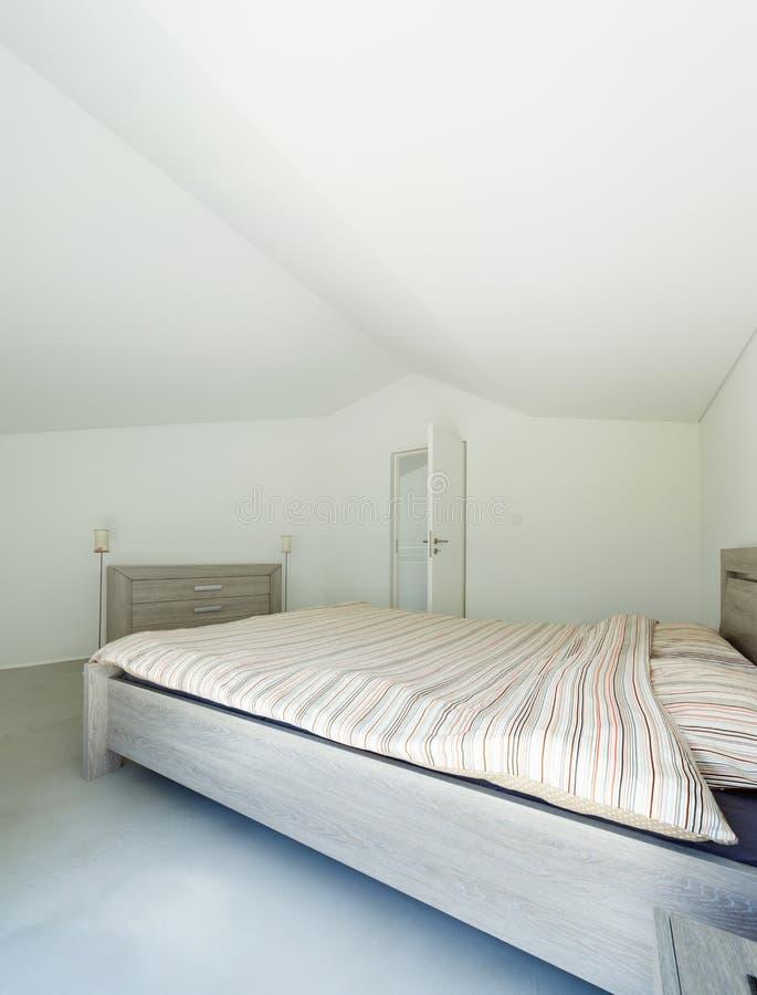 Binnenlands, modern huis, slaapkamer royalty-vrije stock afbeeldingen
