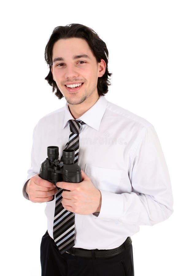 Binocolo della holding dell'uomo d'affari fotografia stock