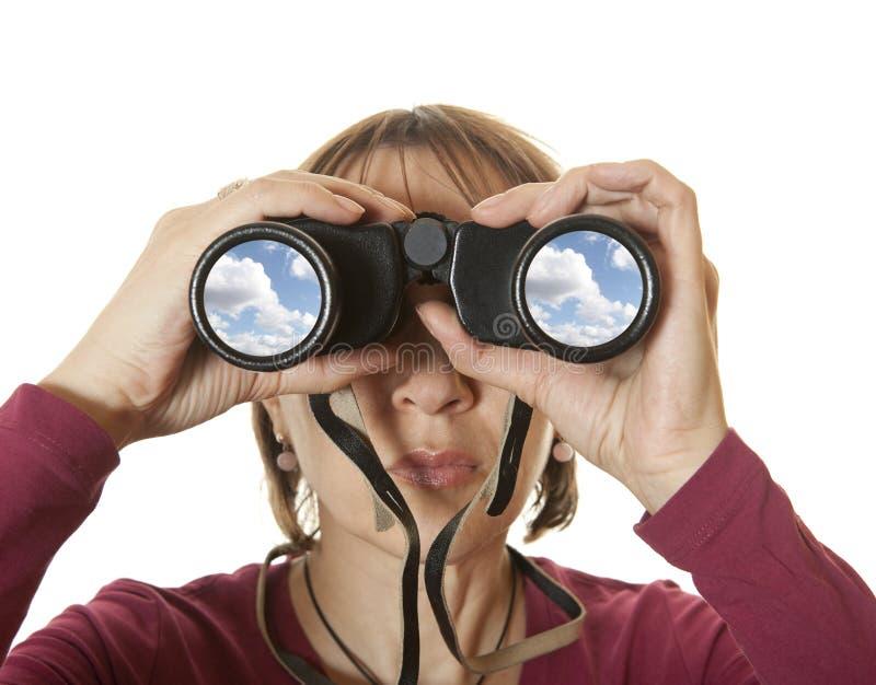 Binocular. Woman looking with binoculars. Isolated royalty free stock image