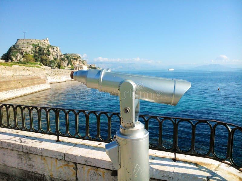 Telescope overlooking sea on Corfu. Telescope for public use on platform overlooking the Mediterranean Sea from Corfu Island, Greece royalty free stock photo