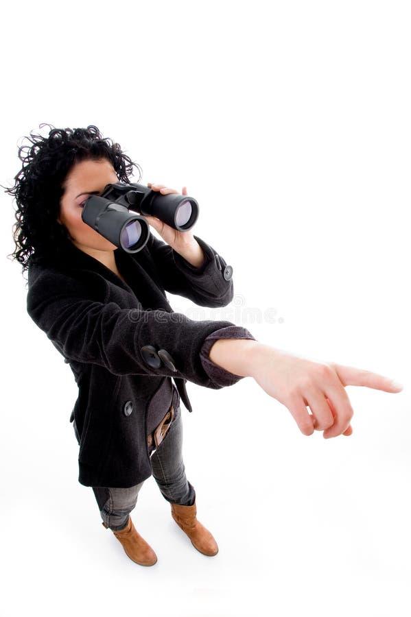 binocular female looking pointing royaltyfri bild