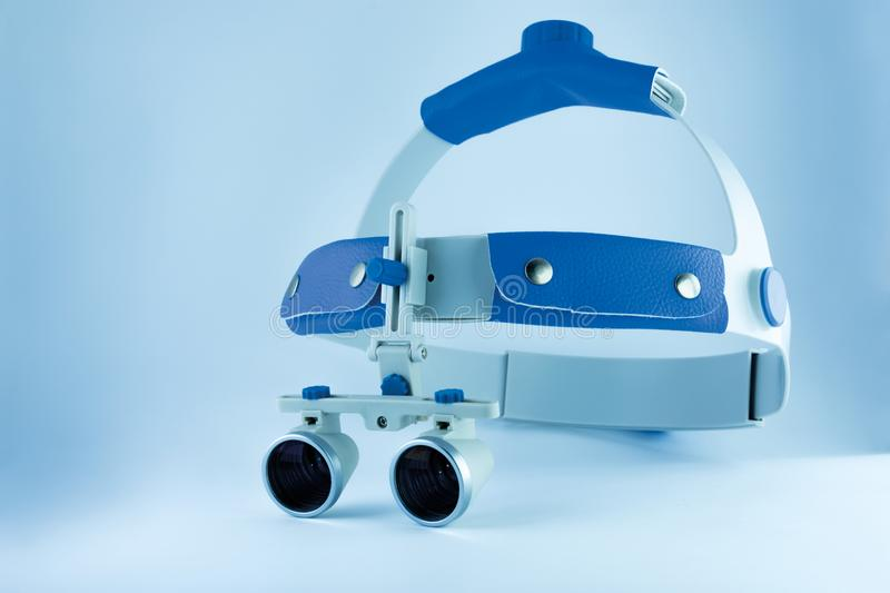 binocular loupes dentistry. Application of optics in the treatment of dental diseases. The concept of new technologies in medicine stock photography