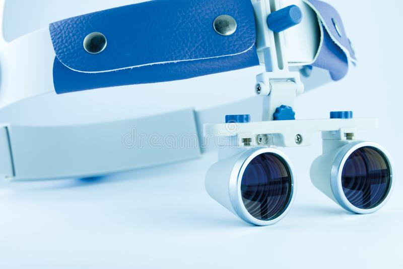 Binocular loupes dentistry. Application of optics in the treatment of dental diseases. The concept of new technologies in medicine stock photos