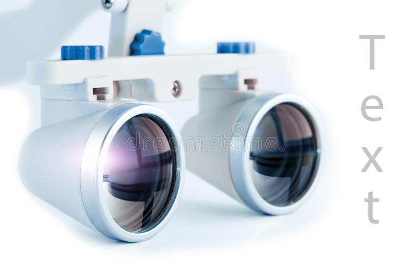 Binocular loupes dentistry. Application of optics in the treatment of dental diseases. The concept of new technologies in medicine stock photo