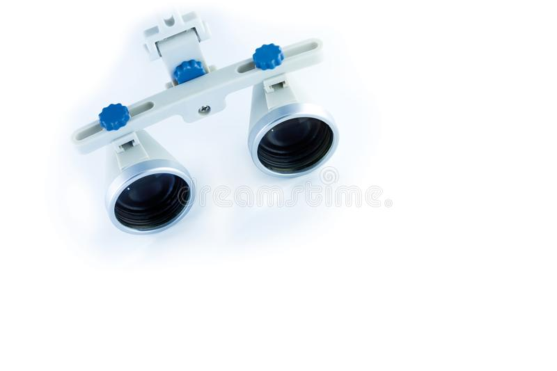 Binocular loupes dentistry. Application of optics in the treatment of dental diseases. The concept of new technologies in medicine royalty free stock photos