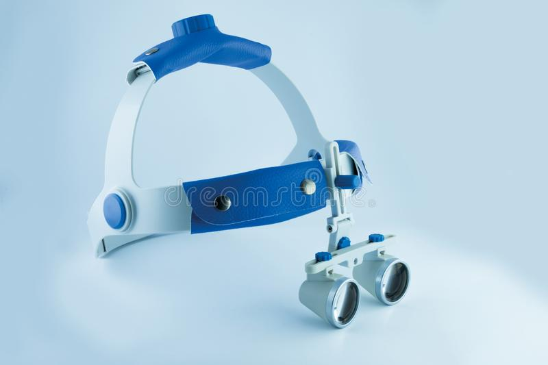 Binocular loupes dentistry. Application of optics in the treatment of dental diseases. The concept of new technologies in medicine stock image