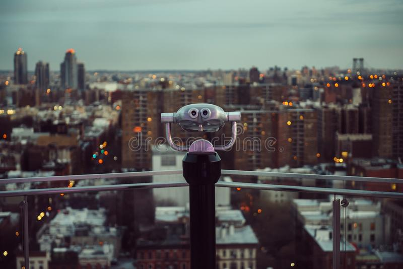 Binocular on the rooftop balcony with the view to New York City streets royalty free stock photo