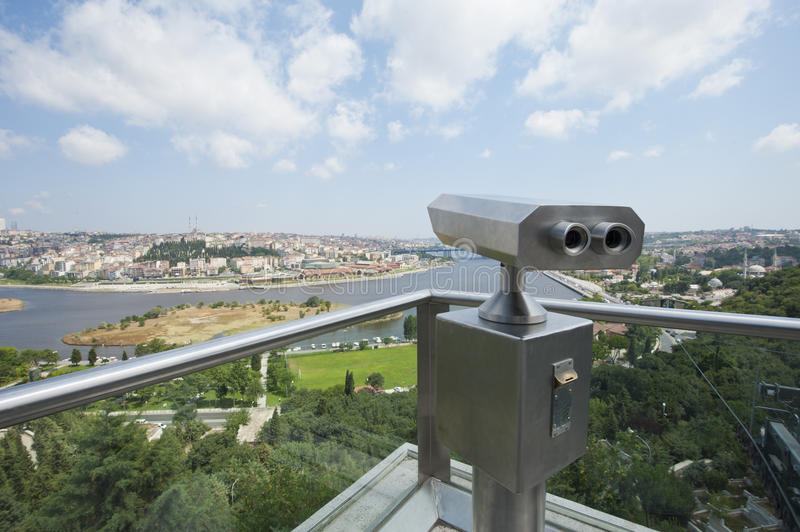 Binoculars on an aerial viewing platform over city. Pair of binoculars on an aerial viewing platform overlooking istanbul from famous Pierre Loti Cafe stock image