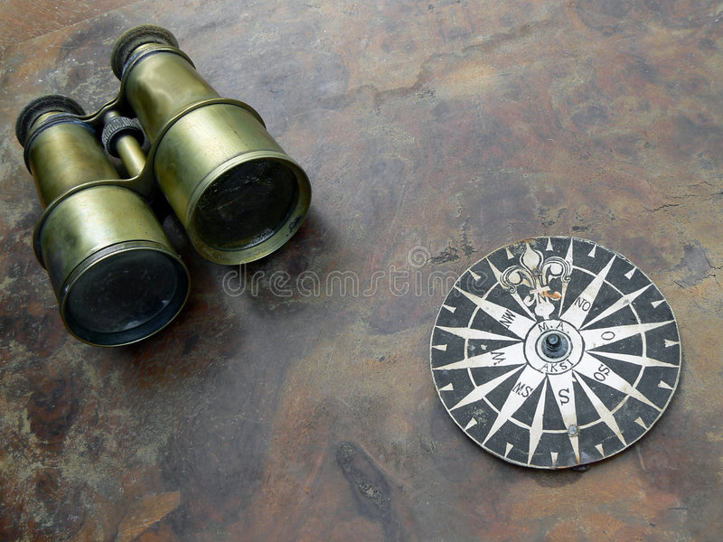 Binoculars and compass royalty free stock images