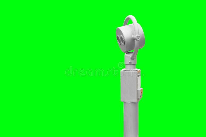 Binoculars for exploring the city. Silver color telescope on a green background, isolated. Paid viewing royalty free stock photo