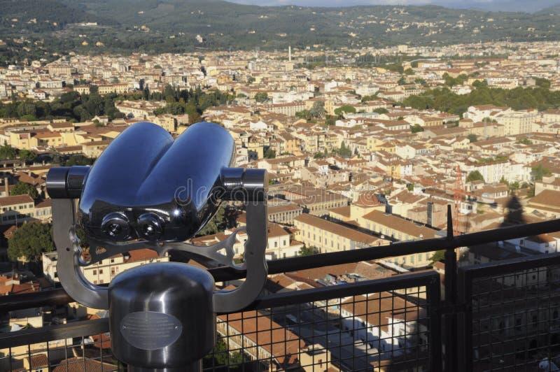 Binoculars and Florence city stock photo