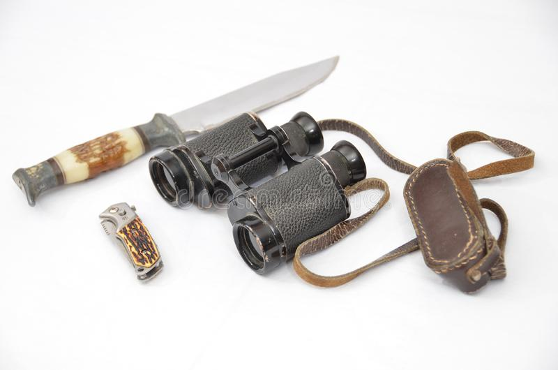 Binoculars and knifes royalty free stock image