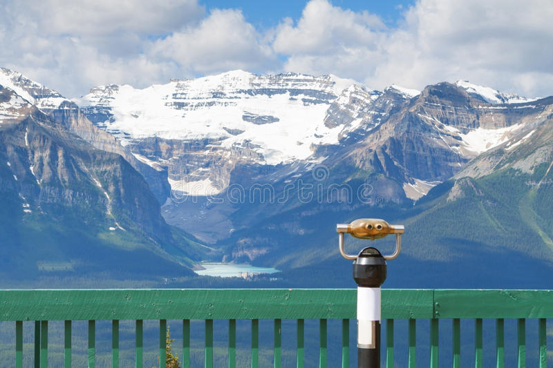 Binoculars With Lake Louise View. Lake Louise In Banff National Park And The Canadian Rockies royalty free stock images