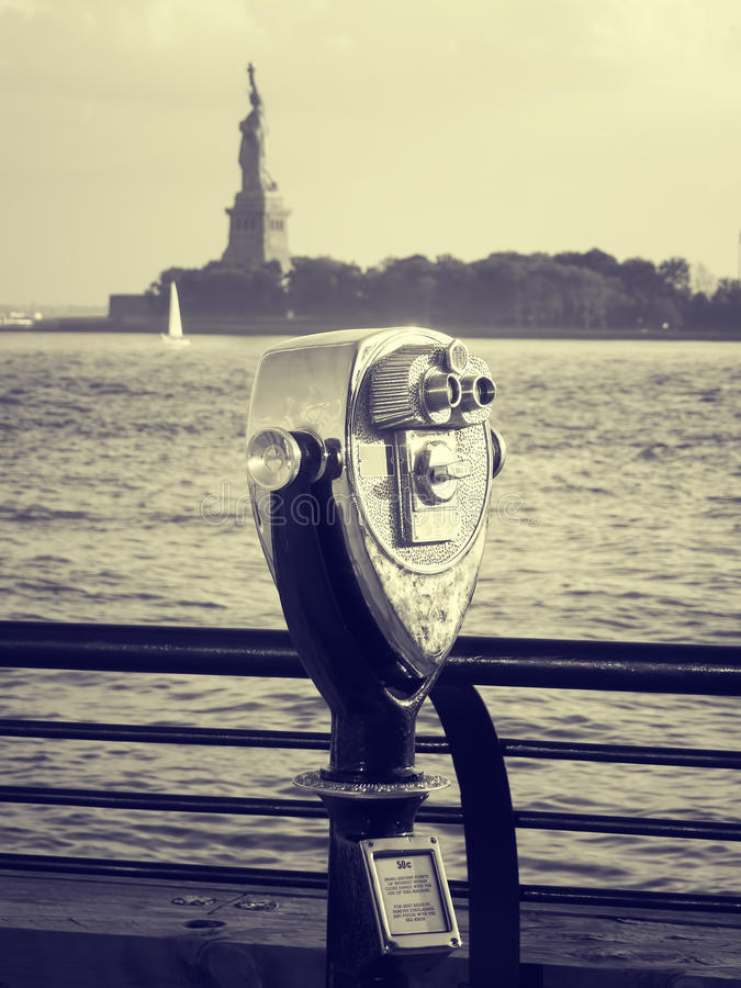 Binoculars looking at the Statue of Liberty in New York royalty free stock photo