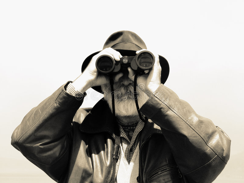 Binoculars - Man Explorer Stock Photo