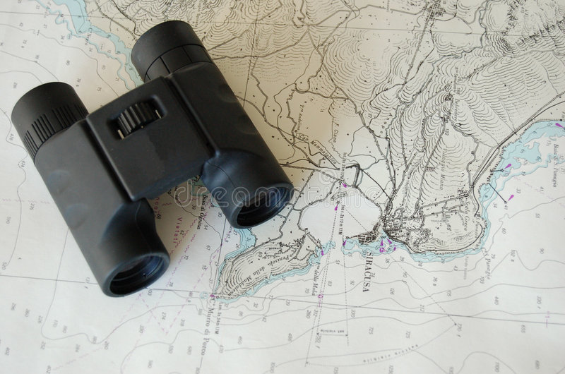 Binoculars over map royalty free stock photography