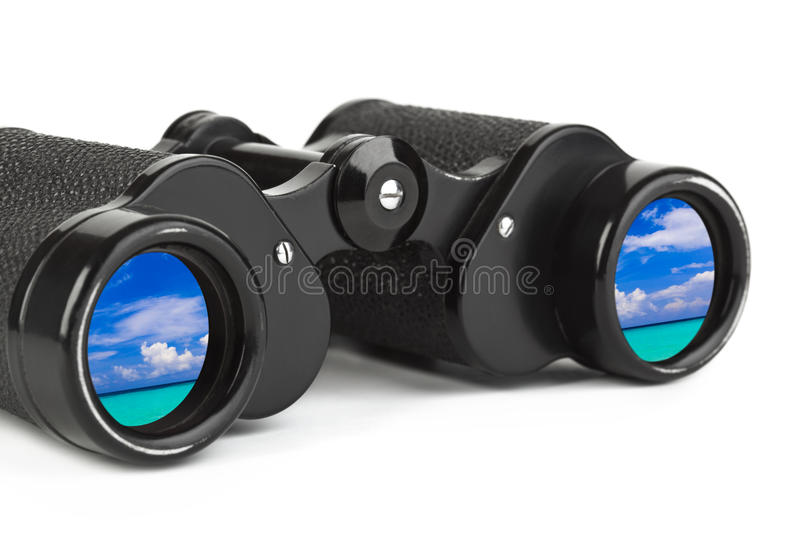 Binoculars and reflection of sea and sky royalty free stock images