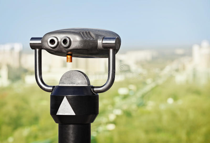 Binoculars To Observe Green City Royalty Free Stock Photography