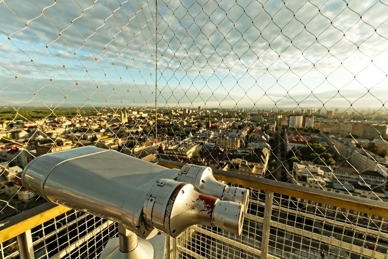 Binoculars on top of Ostrava city tower. Evening Ostrava city from above from town hall tower. Cage and binoculars on the top of city hall tower royalty free stock images