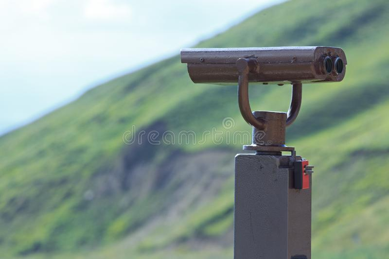 Binoculars on a viewing platform for observing flora, fauna royalty free stock image