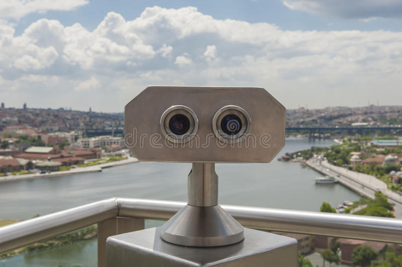 Binoculars on viewing platform overlooking river. Binoculars on viewing platform overlooking Bosphorus river and Istanbul Turkey from famous Pierre Loti Cafe royalty free stock image
