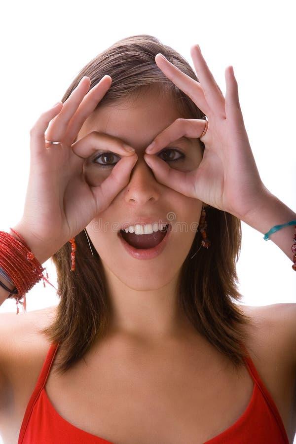 binokulära händer som ser teen arkivfoto