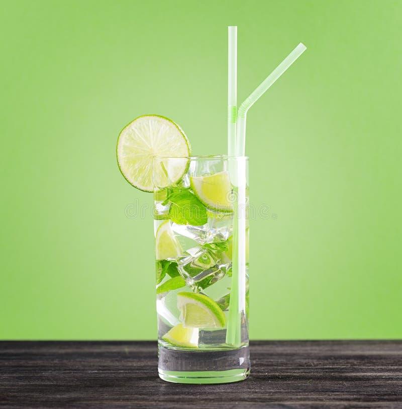 Glass of mojito cocktail on pastel green backgroun stock photos