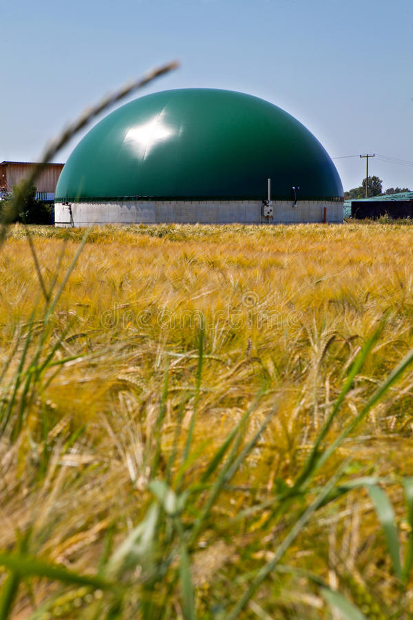 Bio gas plant in a corn field. (Germany royalty free stock image