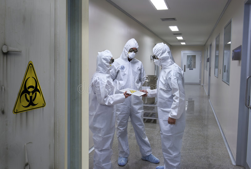Bio Hazard Team. Bio-hazard scientists receiving a confidential document stock images