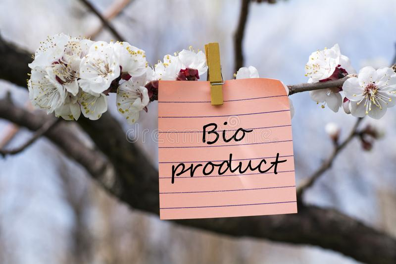Bio product in memo. Pined on tree with blooms stock photos
