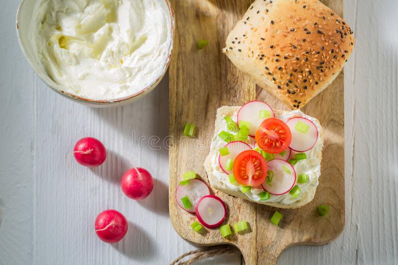 Bio sandwich with crunchy bread, fromage cheese and radish. On white background stock photos