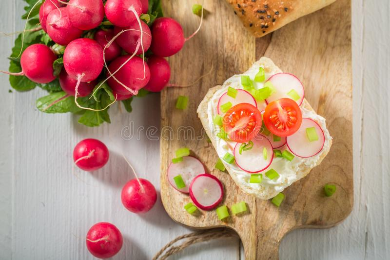 Bio sandwich with fromage cheese and cherry tomatoes. On white background royalty free stock images