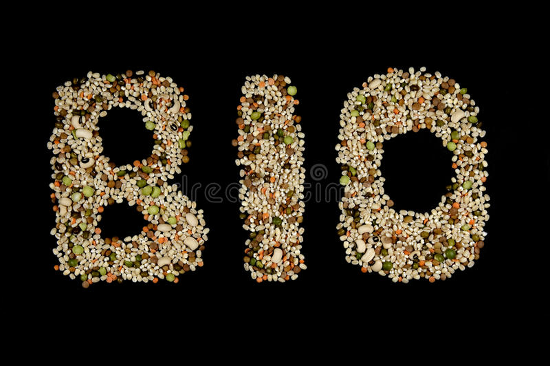 Bio written with biological cereals and vegetables stock images