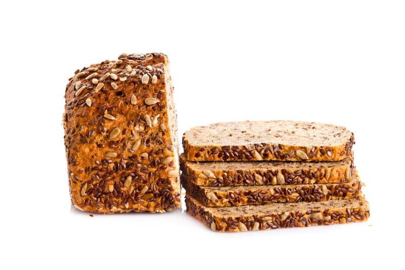 Biobread del seme di Brown isolato sull'alimento sano del fondo bianco fotografia stock libera da diritti