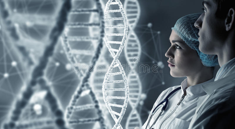 Biochemistry scientists at work . Mixed media royalty free stock photo