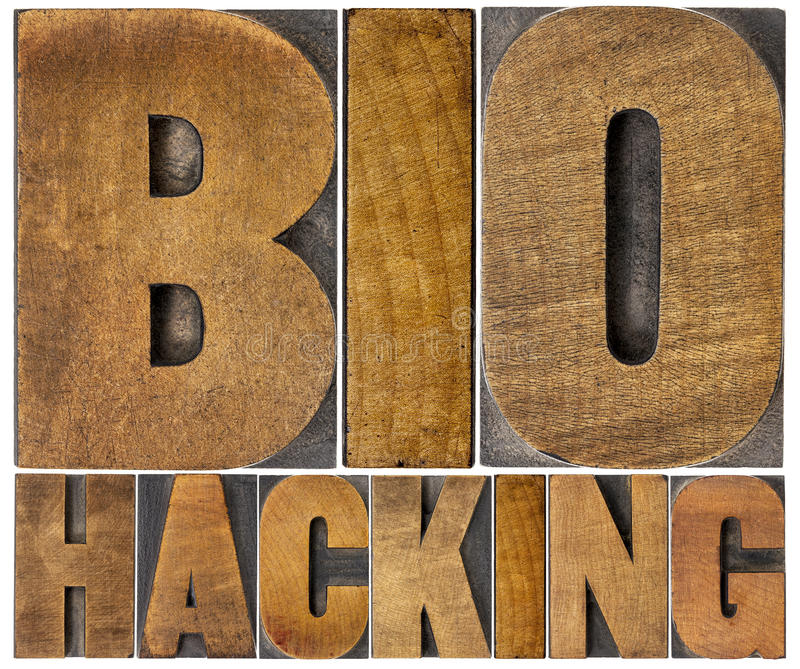 Biohacking word abstract in wood type stock images